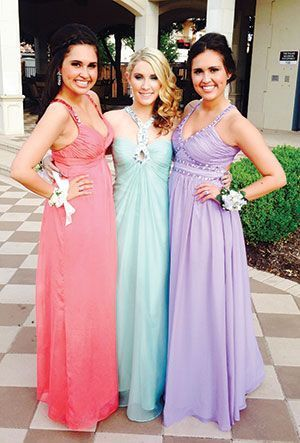 Whitney Hill, center with friends, Emily Sunshine, left, and Allie Sunshine at Plano West Senior High Prom, 2014.