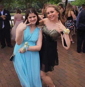 "Sydney, left, with Lindsay at the Plano West Best Buddies Prom in May. Sydney says of Lindsay, ""She is nice and pretty and she's my best buddy!"""