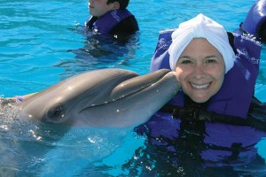 Swimming with the dolphins….Lauren celebrates the end of cancer treatment in Cabo, Mexico with friends and family.