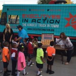 The Executives in Action Kindness truck offers Random Snacks Of Kindness to students at St. Phillips School and Community Center in Dallas.