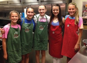 Isabella Chaiken, Bethany Kula, Sydney Gray, Carly Neal and Logan Meade volunteering at Ronald McDonald House.
