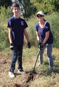 Melissa Chaiken with son, Spencer, 15, working at Plano Community Garden as volunteers from the YMSL Silver Star Chapter.