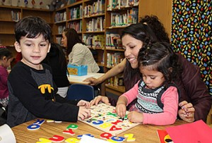 Parents and their preschool aged children spend 20 hours a week learning together at two sites in Plano ISD: Plano Family Literacy School and Sigler Elementary School. Pictured: Carolina Escobar, Jose and Zoe