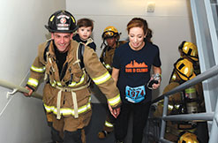 You can help by attending events that are working to make a cure for cancer a reality like the Leukemia & Lymphoma Society's annual Big D Climb, Pictured here: A Dallas firefighter, whose 2-year old son, Max, has a rare form of leukemia, joined over 2300 participants to climb 70 stories at Bank of America Plaza, the tallest building in downtown Dallas, in support of blood cancer research.  Over 50 Dallas firefighters made the climb in full gear.  Since its inception, the event has raised over $1,000,000.