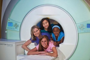 Pictured here, young friends check out the spacious MRI at Envision Imaging.