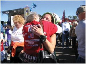 """My mother taught us love, responsibility, forgiveness and perseverance,"" says Selec, shown here hugging her mom, Beverly Darcey, at her first race at Disney World in honor of Trey."