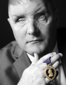 man holding purple heart