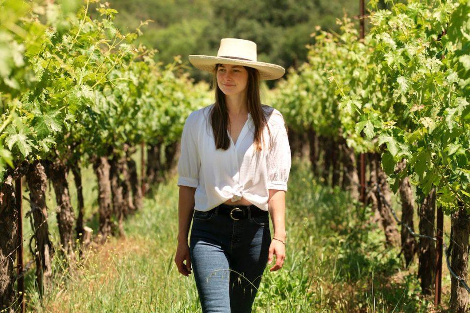 woman walking in wine vineyard