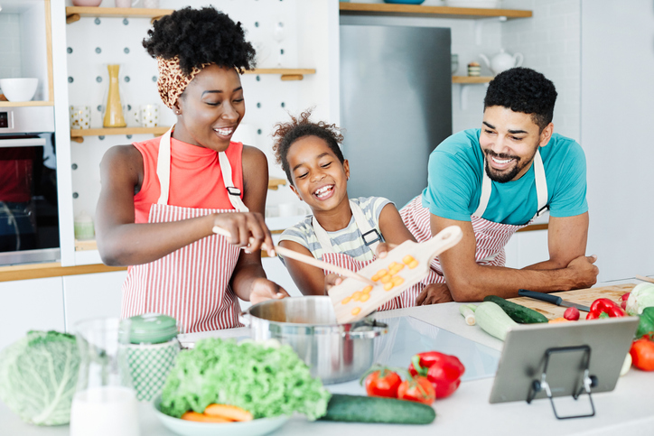 Family preparing meal and having fun in the kitchen at home