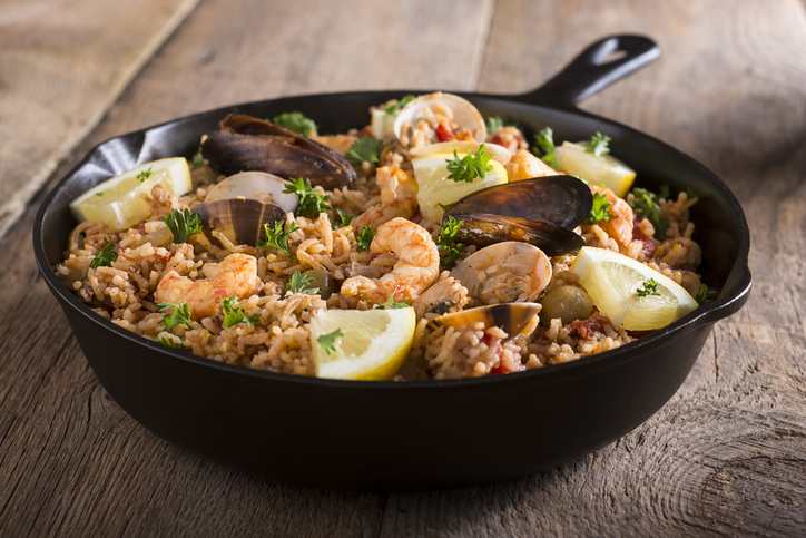 Paella -- Spanish Seafood and Rice Dish in Skillet